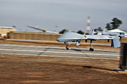On The Runway Photos - An Mq-1c Sky Warrior Uav Lands At Camp by Stocktrek Images