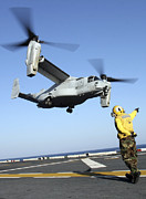 Flight Deck Posters - An Mv-22 Osprey Launches From The Uss Poster by Stocktrek Images