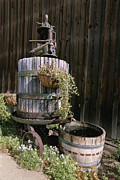 Barrels Prints - An Oak Barrel And Grape Press Fountain Print by Rich Reid