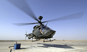 Helicopter Pilot Framed Prints - An Oh-58d Kiowa Warrior Helicopter Framed Print by Stocktrek Images