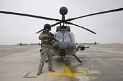 Airfield Prints - An Oh-58d Kiowa Warrior Pilot Stands Print by Terry Moore