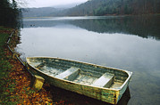 Autumn Scenes Photos - An Old Rowboat On The Shore Of Douthat by Raymond Gehman