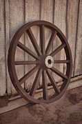 An Old Wagon Wheel Print by Donna Van Vlack