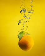 Orange. Prints - An Orange Splashed Into Water Print by Henrik Sorensen
