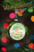 Flare-up Prints - An Ornament With A Reindeer Hanging Print by Craig Tuttle
