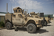 Combat Vehicles Framed Prints - An Oshkosh M-atv Parked At A Military Framed Print by Terry Moore