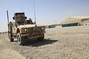 Mrap Photos - An Oshkosh M-atv Sits Parked At Camp by Stocktrek Images