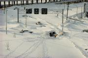 Winter Roads Art - An Overhead View Of Buried Cars On An by Ira Block