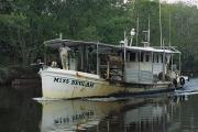 Delacroix Photo Prints - An Oyster Boat Plies The Waters Print by Medford Taylor
