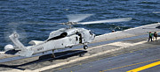 Flight Deck Posters - An Sh-60f Sea Hawk Helicopter Lands Poster by Stocktrek Images