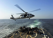 Pallet Framed Prints - An Sh-60r Sea Hawk Delivers Pallets Framed Print by Stocktrek Images