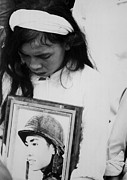 Candid Portraits Prints - An Young Vietnamese Widow Mourns Print by Everett