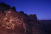 Night Scenes Photos - Ancient Rock Art Showing Kokopelli by Ira Block