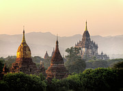 Buddhism Photos - Ancient Temples At Sunset by Tom Horton, Further To Fly Photography