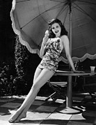 Full-length Portrait Metal Prints - Ann Miller Eating Ice Cream, Ca. 1941 Metal Print by Everett