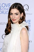 Curled Hair Prints - Anne Hathaway At Arrivals For Love And Print by Everett