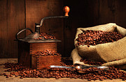 Java Prints - Antique coffee grinder with beans Print by Sandra Cunningham
