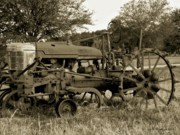 Garden Plow Photos - Antique Tractor In Sepia by Betty Northcutt
