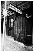 Black And White Prints Prints - Antoines Restaurant Noir Print by John Rizzuto