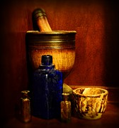 Medicine Bottle Framed Prints - Apothecary - Wood mortar and pestle Framed Print by Paul Ward