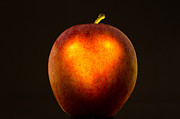 Passion Fruit Posters - Apple with a illuminated heart Poster by Mats Silvan