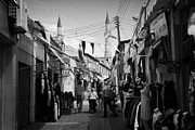 Cumhuriyeti Prints - arasta street shopping area leading from border checkpoint to the selimiye mosque in nicosia TRNC Print by Joe Fox