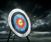 Archery Art - Archery Target With Arrows, Dark Clouds In Background by Getty Images