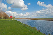 Flevoland Art - Architecture along a canal in spring by Jan Marijs