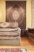 Rugs Prints - Area Rugs in a Store Print by Jetta Productions, Inc