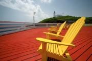 Arecibo Prints - Arecibo Lighthouse with Yellow Chairs Print by George Oze