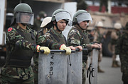 Bracing Prints - Argentine Marines Dressed In Riot Gear Print by Stocktrek Images
