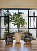 Flooring Prints - Armchairs in Front of a Large Window Print by Noam Armonn