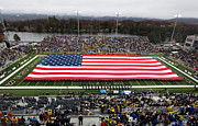 Army Photo Framed Prints - Army An American Flag Spans Michie Stadium Framed Print by Associated Press