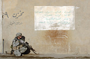 Operation Iraqi Freedom Art - Army Specialist Kneeling Next To A Wall by Stocktrek Images