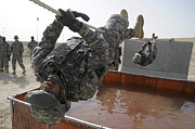 Teammates Prints - Army Specialist Uses A 15 Foot Rope Print by Stocktrek Images