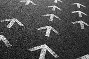 Grainy Photos - Arrows on Asphalt by Carlos Caetano