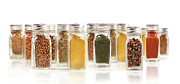 Chili Framed Prints - Assorted spice bottles isolated on white Framed Print by Sandra Cunningham