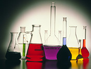 Flasks Prints - Assortment Of Laboratory Flasks Holding Solutions Print by Tek Image