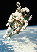 Astronomy Photo Posters - Astronaut In Space Poster by NASA / Science Source