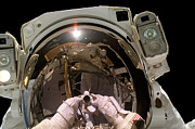 Self-portrait Photos - Astronaut Takes A Self-portrat by Stocktrek Images