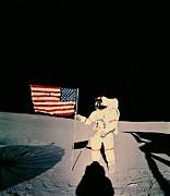 Program Framed Prints - Astronaut With Us Flag On Moon Framed Print by Nasa