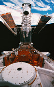 Aerospace Photos - Astronauts Working On A Satellite Docked On The Space Shuttle by Stockbyte