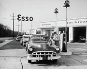 1940-1949 Prints - Attendant At Esso Serving Customer, Circa 1949 Print by Archive Holdings Inc.