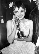 Award Posters - Audrey Hepburn With Her Academy Award Poster by Everett