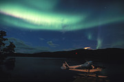 Yukon River Prints - Aurora Borealis Over Small Airplane Print by Nick Norman