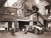 Courtyards Prints - Automobile And Two Motorcycles Print by Everett