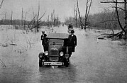 Floods Posters - Automobiles On A Flooded Road Poster by Everett