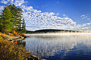 Beautiful Scenery Prints - Autumn lake shore with fog Print by Elena Elisseeva