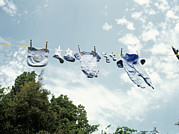 Baby Clothes Posters - Baby Clothes Drying Poster by Ian Boddy