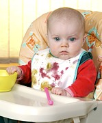 Highchair Posters - Baby In High Chair Eating Poster by Martyn F. Chillmaid